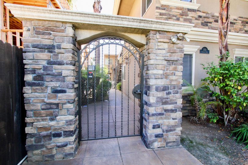 An entryway with stone cladding in the Felspar Park community.