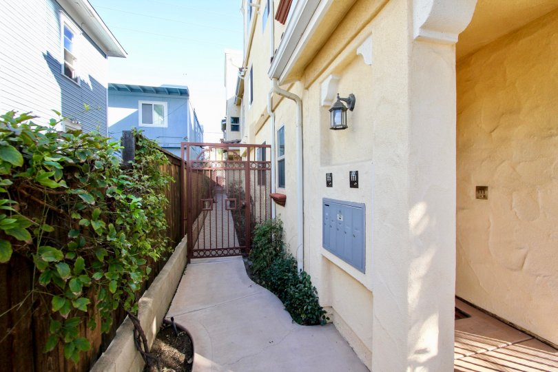 A sunny day in the area of Hornblend Condos, outside, gated entrance, sidewalk, hallway