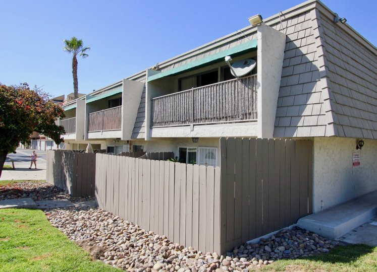 A two-storey residence with gray roofing and fence in La Casa Villa community.