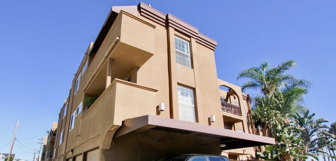A three-storey residence with roofed parking in La Jolla Bella community.