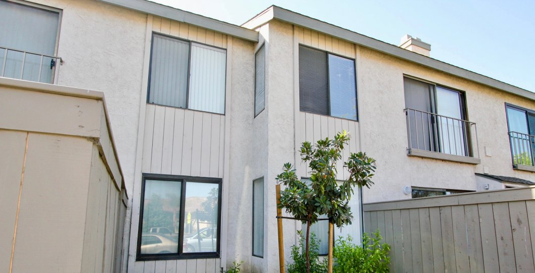 A simple two-storey residence with sliding windows in La Portola community.