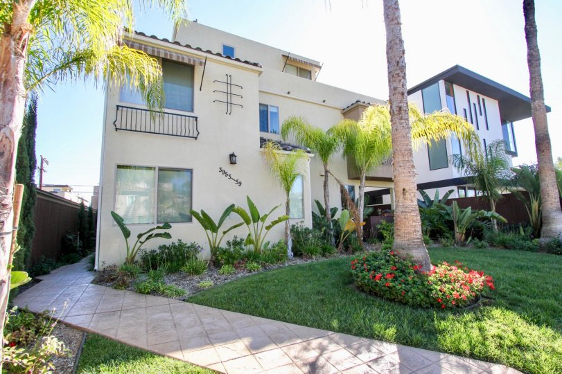 Multi-story townhome complex with beautiful landscaped exterior in Pacific Beach, California