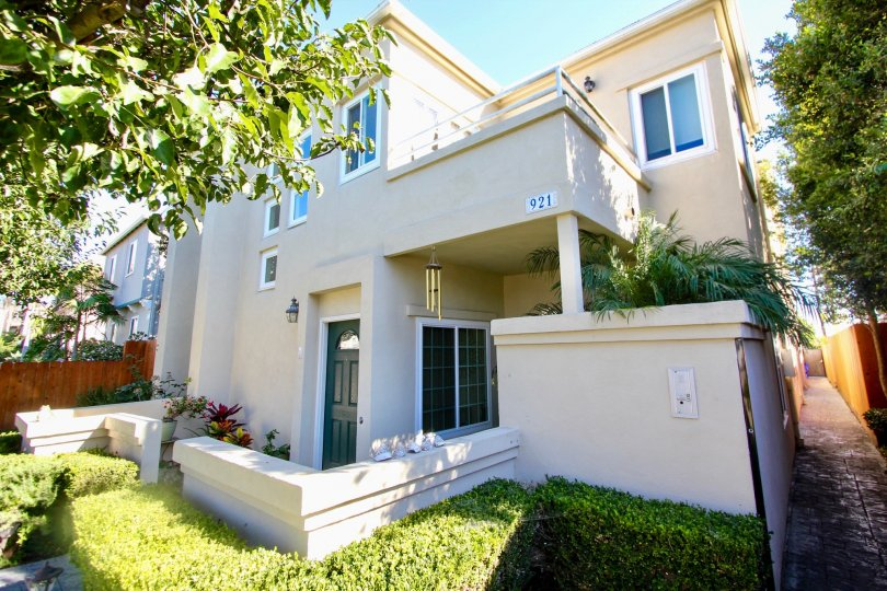 A two-storey residence with a low fence and painted in white color in Law Street community.