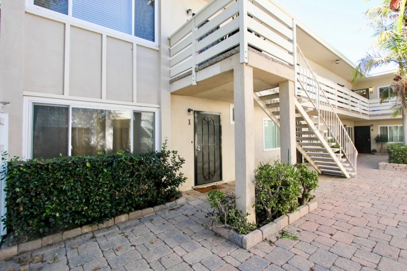 A House with spacious front end having staircase and green trees in Loring Manor of Pacific Beach