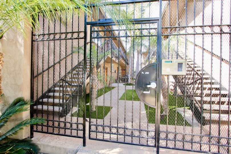 The privacy gate entrance of the Missouri Pacific apartment complex, shwoing a portion of the courtyard.