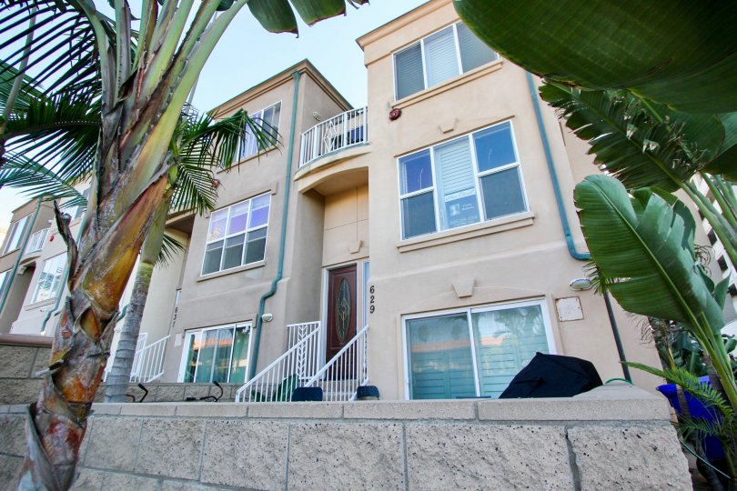 A sunny day in North Pacific Beach Row Homes with beautiful Grden and dates