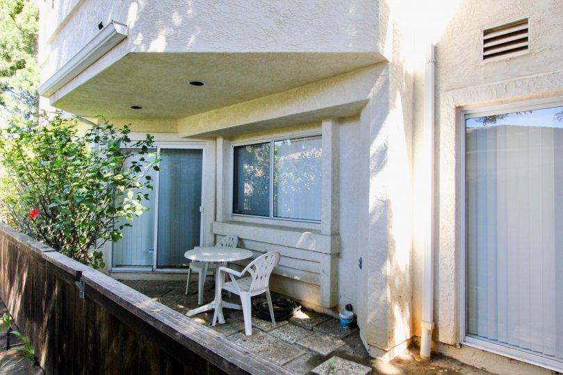 Glass sliding doors and small porch area at Oliver Avenue Condos in Pacific Beach, California