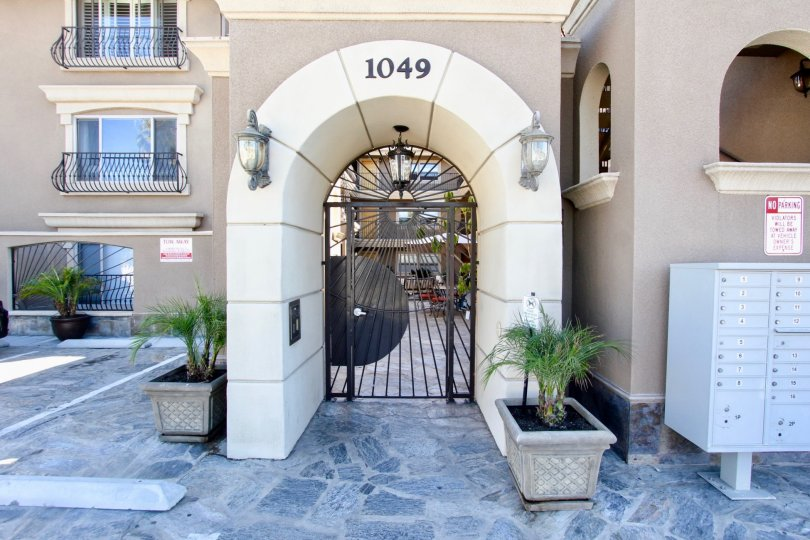 A decorative arched entryway to the Pacific Villas community.