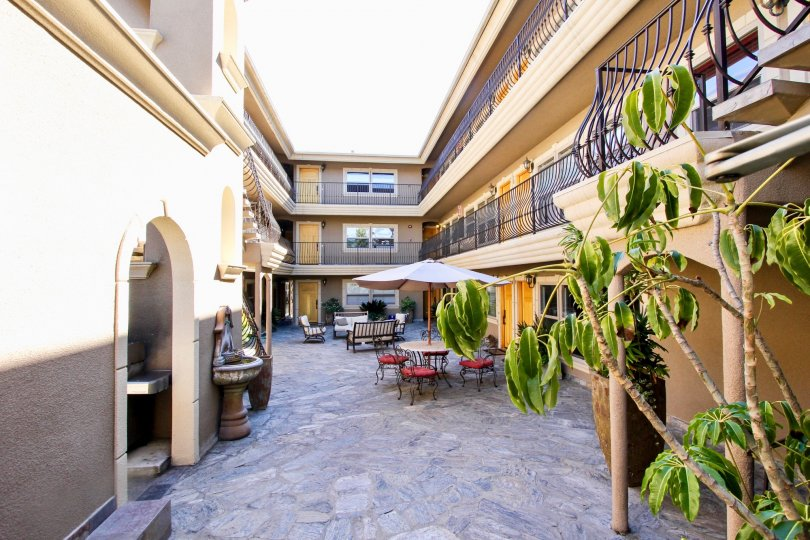 A sunny day in the area of Pacific Villas, outside, terrace, umbrella, fountain, table, balcony