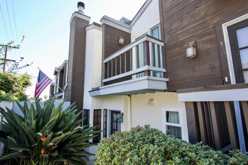 Beautiful view of a villa with USA Flag and garden around in Pacifica Townhomes of Pacific Beach