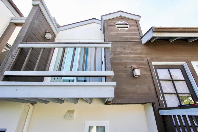 A two-storey residence with wooden cladding in the Pacifica Townhomes community.