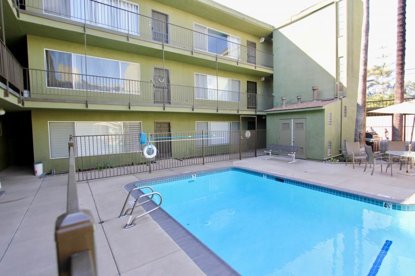 A small pool around three-storey townhouses in the Regency Condos community.