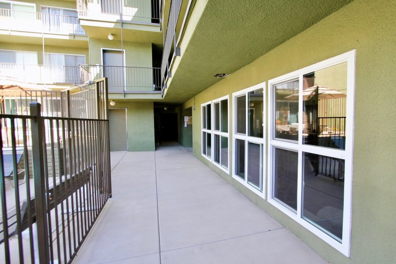Beautiful entrance view of green colour villa in Regency Condos of Pacific Beach