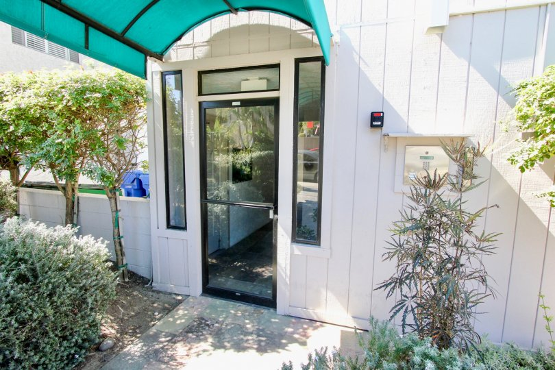 Covered entry doorway and keypad access at the Riviera Sands in Pacific Beach, California