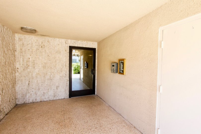 A room with entrance glass door inside a house in Riviera Terrace of Pacific Beach