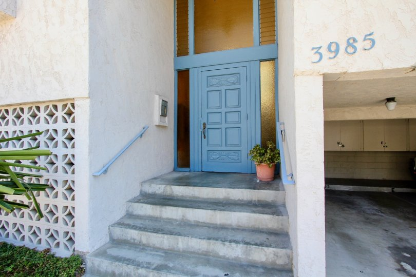 Entrance view with house number and steps in Rivieran of Pacific Bech