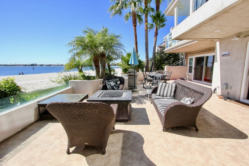 Patio of apartment building overlooking the water with patio furniture at Sail Bay Condos in Pacific Beach, Ca