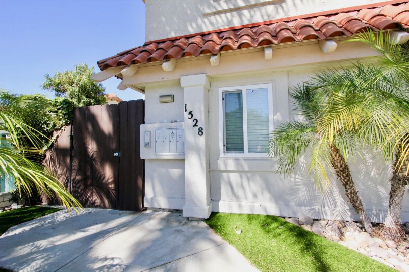 A beautiful house with small trees and lawn in Sand Patch of Pacific Beach