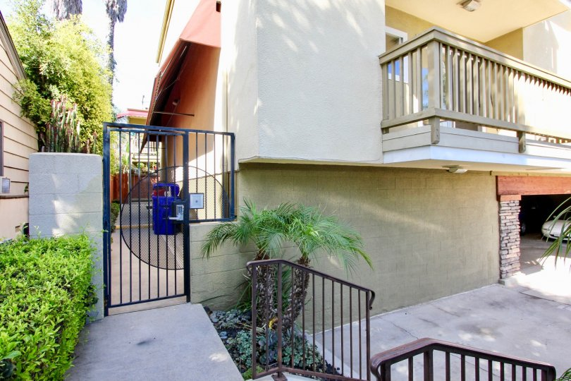 THE APARTMENT IN THE SEA2BAY WITH THE CAR PARKING, PLANTS, TREES, BLUE COLOR GATE, BALCONI