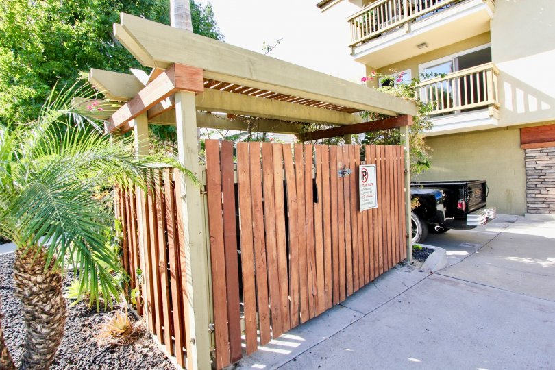 A sunny day in the area of Sea2Bay, truck, condo, balcony, wooden fence