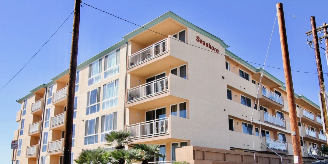 building inpacific Beach, California, hotel or condo in a sunny day with poles in front