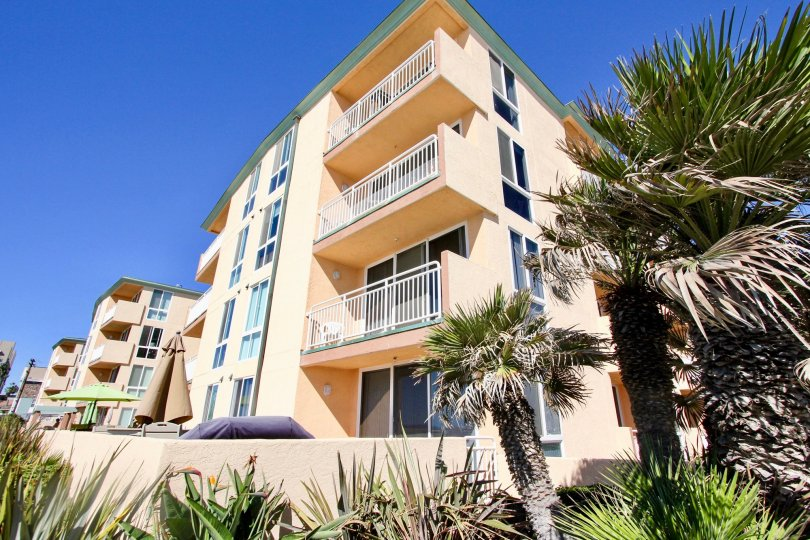 A four story town home building located in the Seashore Community at Pacific Beach CA