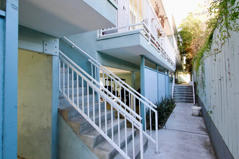 A sunny day in the area of The Heritage on Diamond, outside, sidewalk, balcon, stairsy