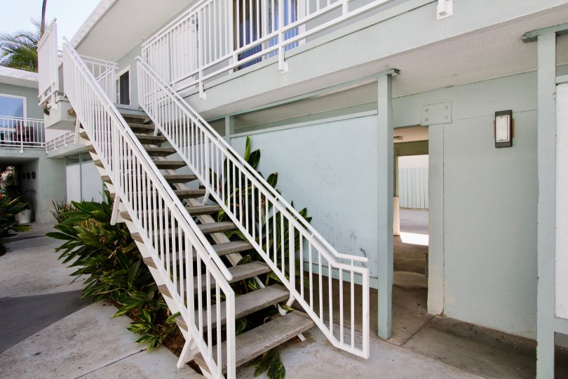 A sunny day in the area of The Heritage on Diamond, outside, sidewalk, stairs, condo