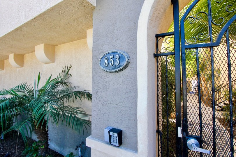The gated security entrance to 853 Thomas Avenue Condominiums in Pacific Beach, California