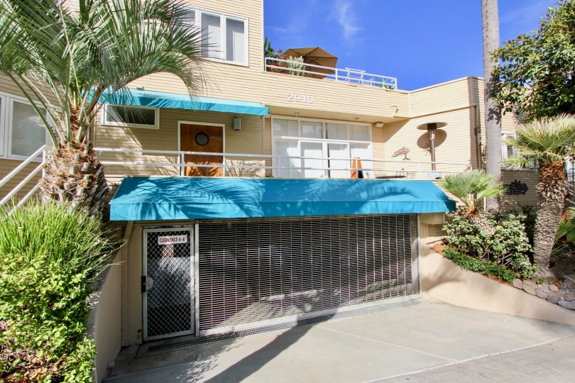 Shuttered garage with secured entrance below unit at La Playa Cove in Point Loma, CA