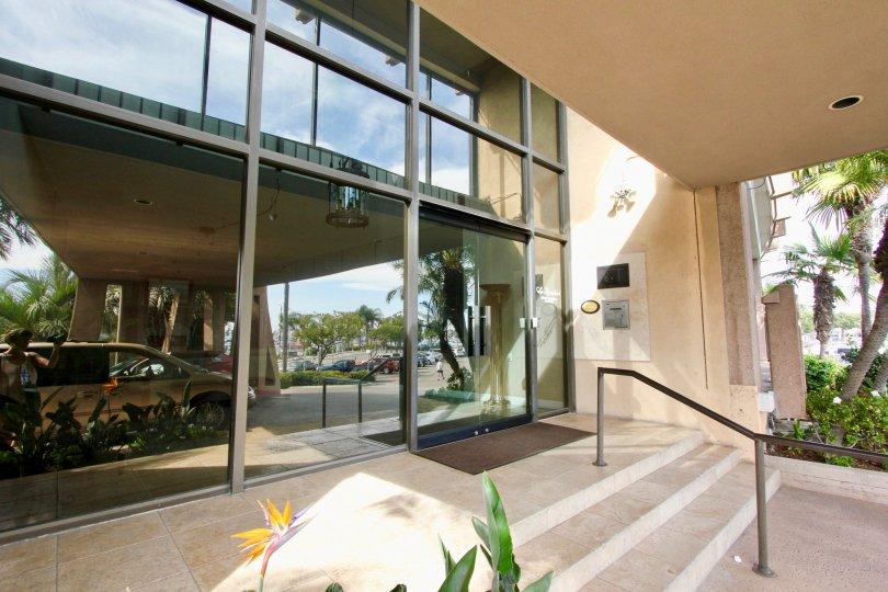 Mirrored glass facade and covered entranceway in Point Loma