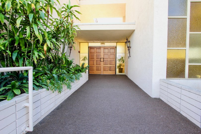 Double doors open up to the walkway in this Point Loma unit.