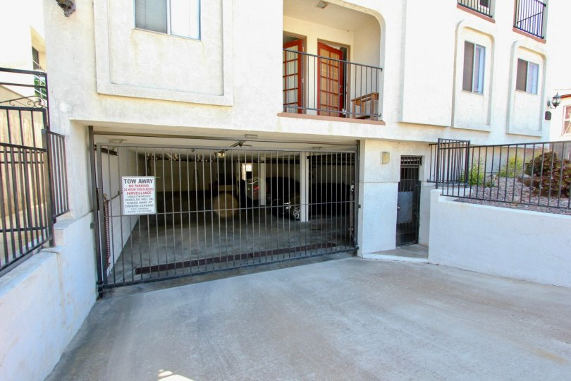 The garage driveway and gate to the parkade of an apartment complex at Primrose Gardens in Point Loma, California