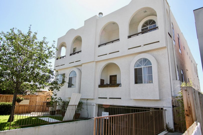 A large building with huge arches over patios in Primrose Villas at Point Loma CA