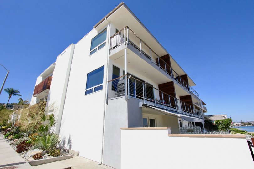 A three story condominium building located in Point Loma CA at Vista De Bahia