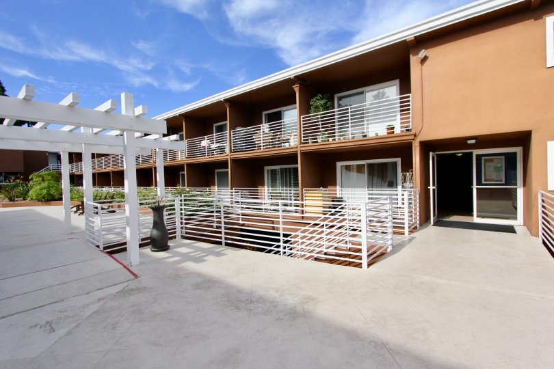 Private terrace for residents with wooden pergola and iron railings at the Yacht Club Condos
