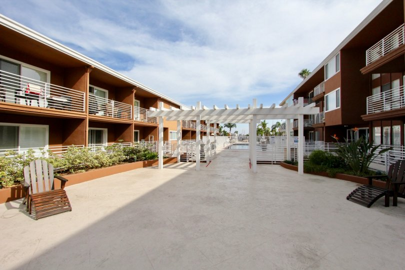 Large communal courtyard with pergola and fenced-in private swimming pool at the Yacht Club Condos