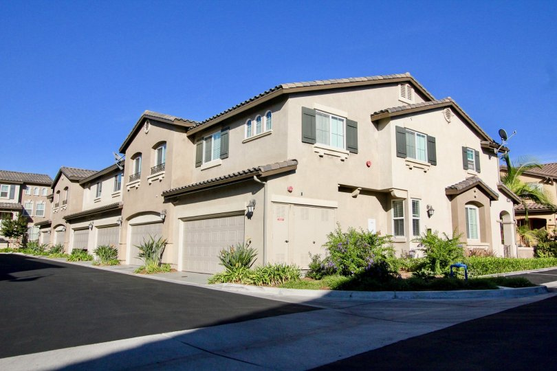 Two story homes with gray garage doors at Amante Ravenna in Rancho Bernardo