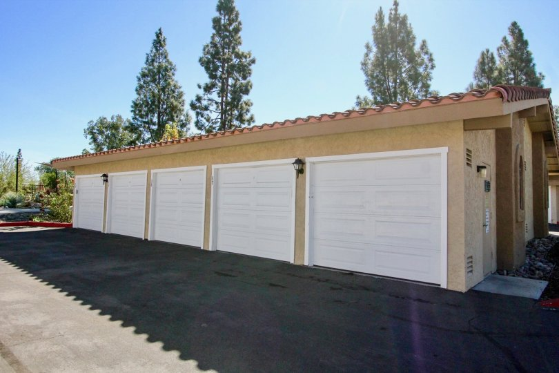 A row of garage doors with some trees in the back in Bernardo Greens, Rancho Bernardo, CA