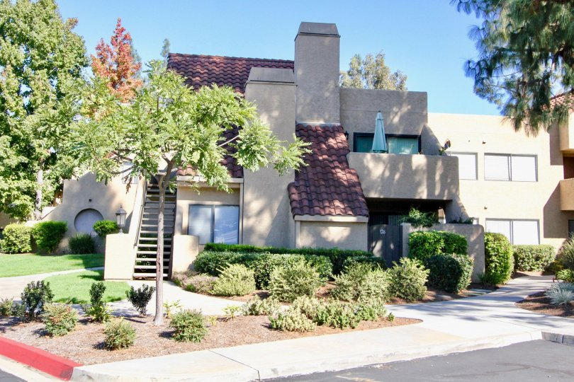 Three story residence with chimney at Bernardo Pines in Rancho Bernardo CA