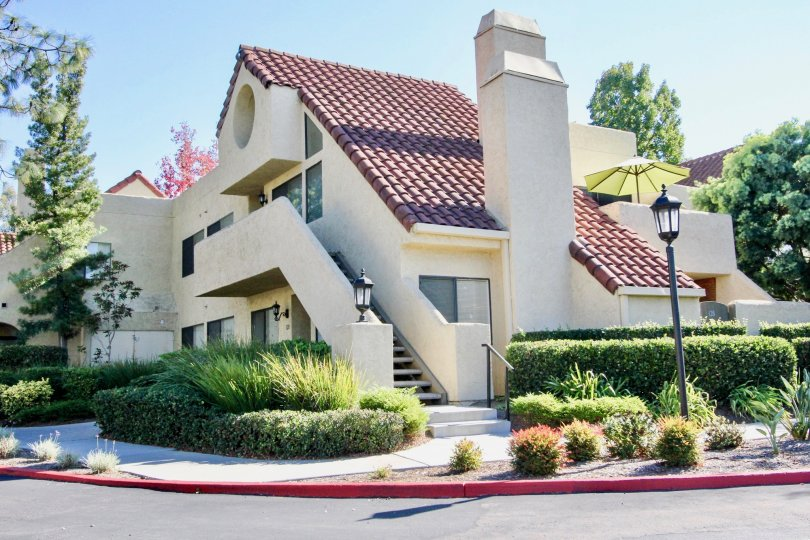Two story condominiums with slanted roof at Bernardo Pines IN Rancho Bernardo CA