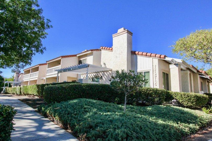 Residential buildings near plants and trees at Bernardo Terrace in Rancho Bernardo California