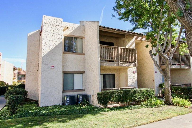 Two story housing with a tree at Bernardo Terrace in Rancho Bernardo CA