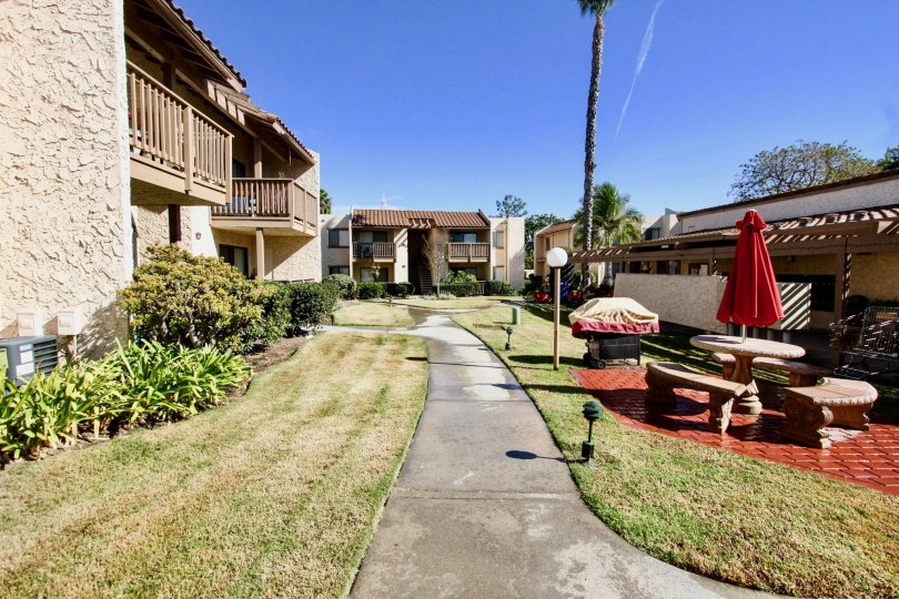 Picnic area in a yard near a residential building at Bernardo Terrace in Rancho Bernardo CA