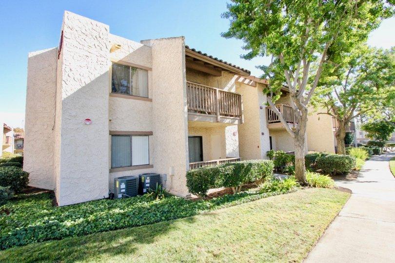 Two story brown units with trees inside Bernardo Terrace in Rancho Bernardo CA