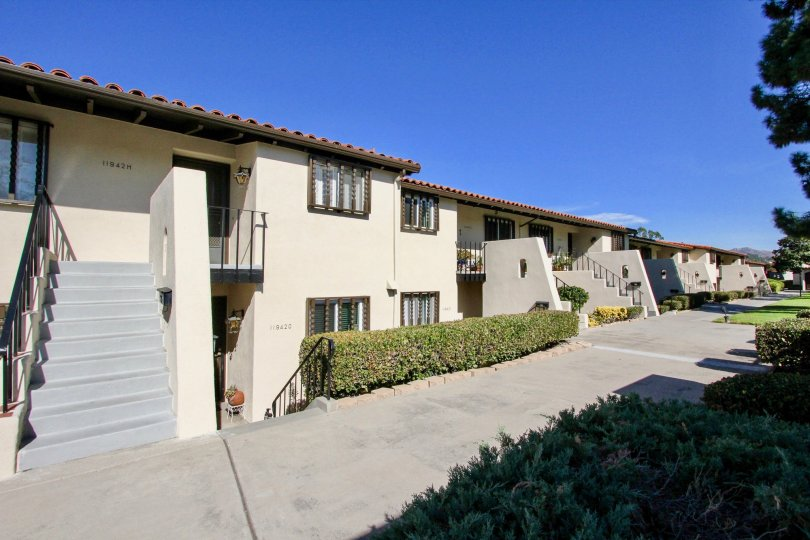 Spanish style apartments with tiled roofs and nice landscaping at Bernardo Villas in Rancho Bernardo, CA.