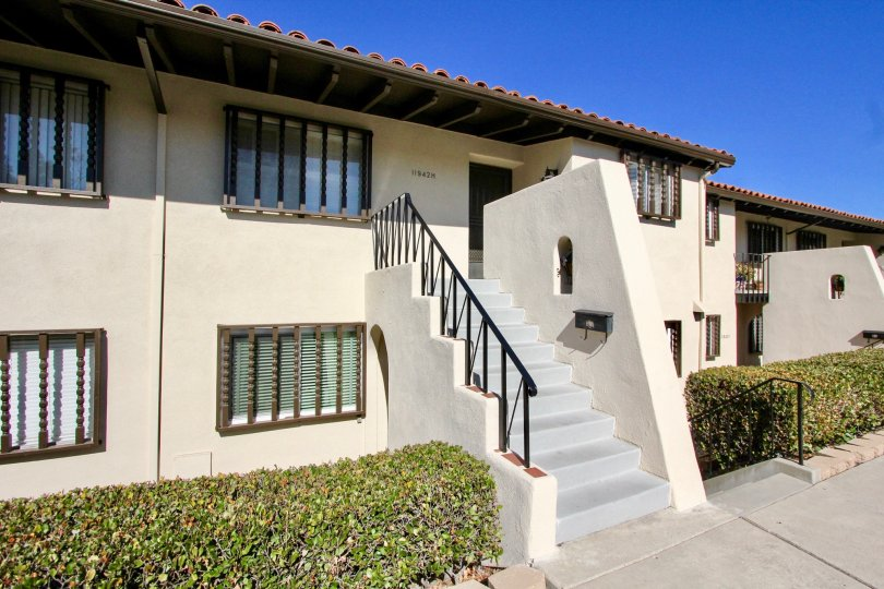 Two story housing with gray stairway at Bernardo Villas in Rancho Bernardo California