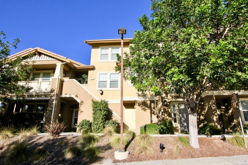 Three story residential building with yard at Bridgeport in Rancho Bernardo California