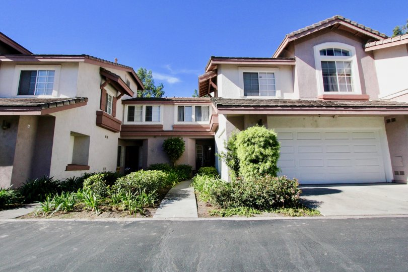 A sunny day in the Collage community in Rancho Bernardo with houses and plants.