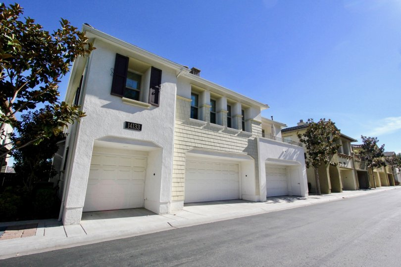 Garages with white doors attached to residence at Cypress Greens in Rancho Bernardo CA